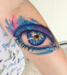 Blue colorful deep eye tattoo