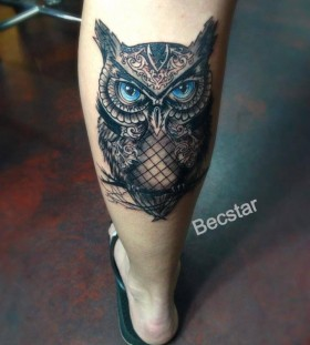Blue eyes owl tattoo