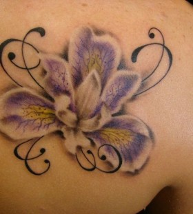 Blue orchid back tattoo