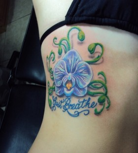 Blue orchid side tattoo