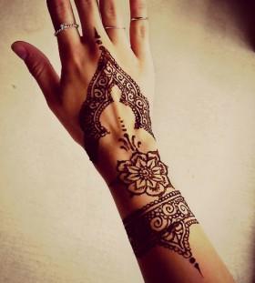 Bohemian style hand tattoo