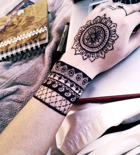 Bohemian style wrist and hand tattoos