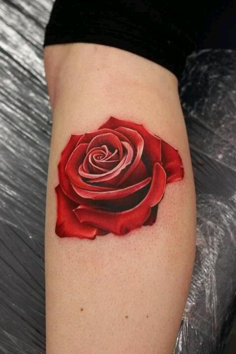 Bright red rose tattoo