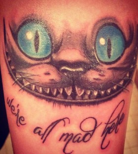 Cheshire Cat we're all mad here arm tattoo
