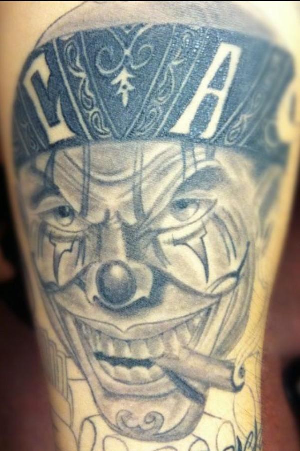 Clown smoking a cigar tattoo