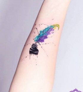 Colorful feather watercolor tattoo