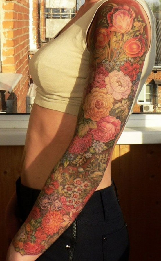 Colorful girl's arm rose tattoo