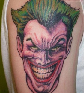 Coloured joker arm tattoo