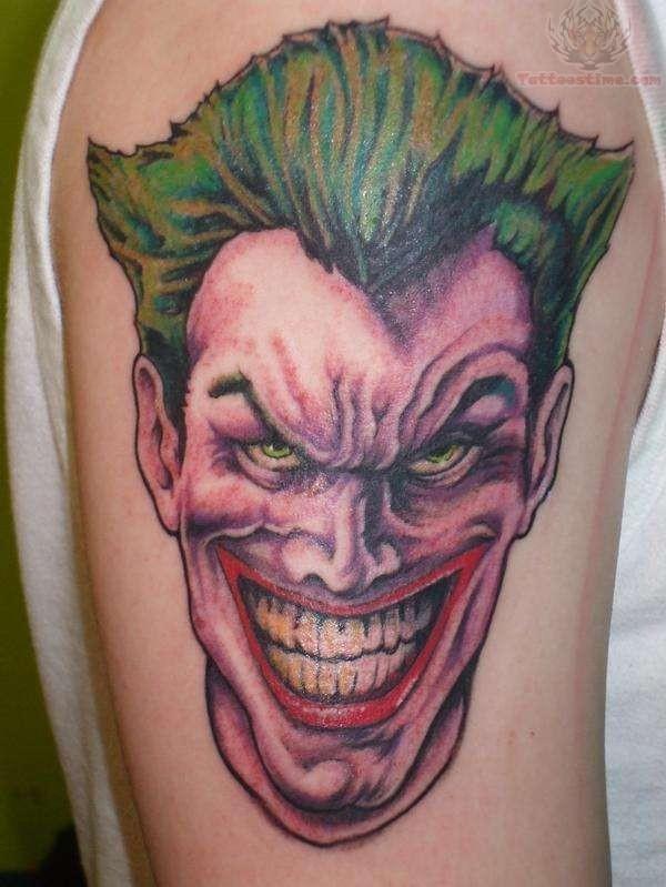 Coloured joker arm tattoo