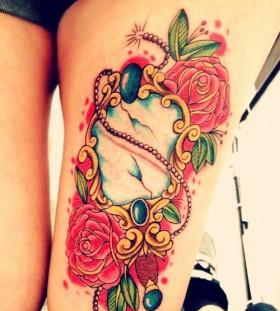 Coloured mirror leg tattoo