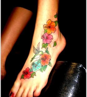 Coloured orchid foot tattoo