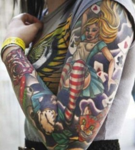 Colourful Alice in Wonderland arm tattoo