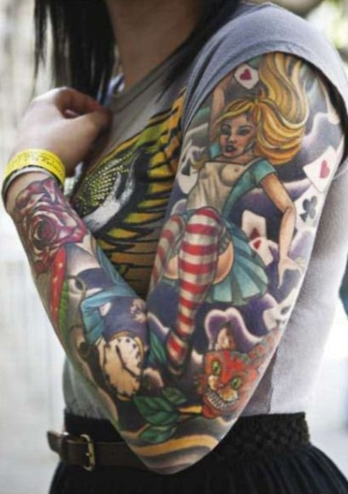 Colourful Alice In Wonderland Arm Tattoo -