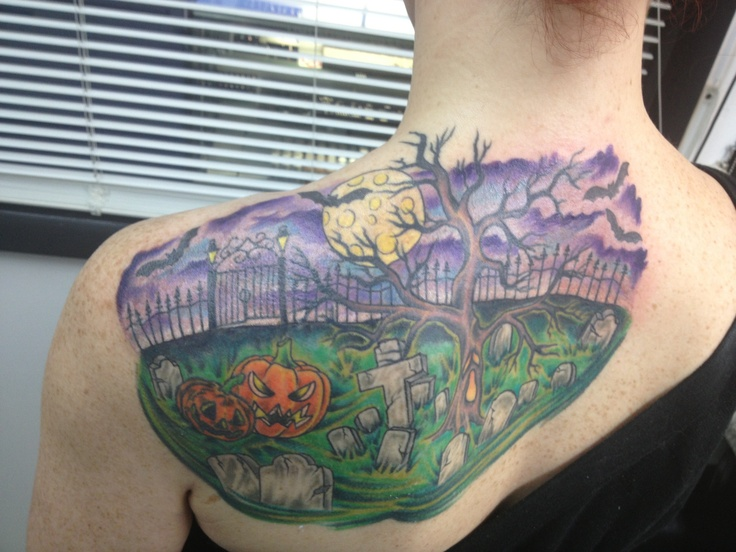Colourful graveyard back tattoo