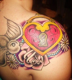 Colourful locket and bird tattoo