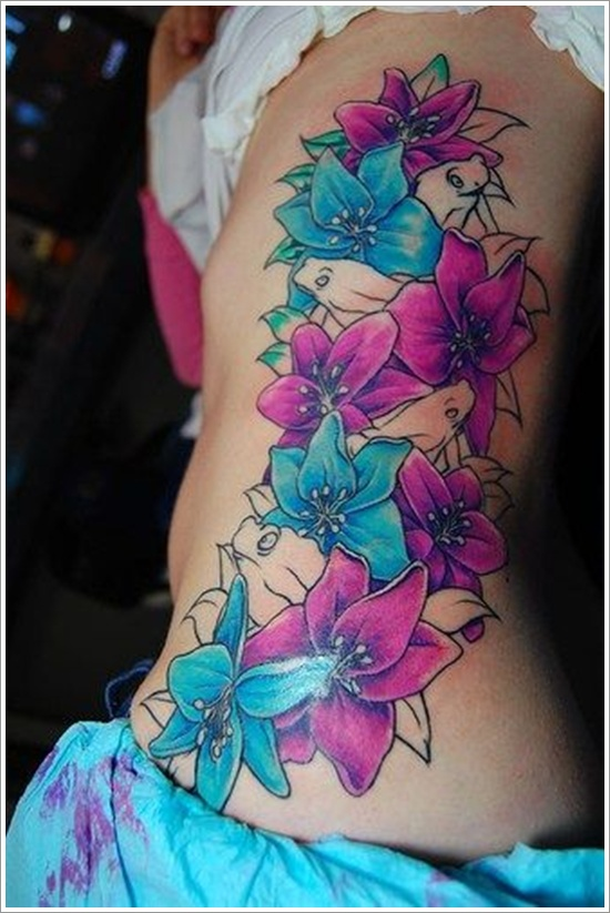 Colourful orchid side tattoo