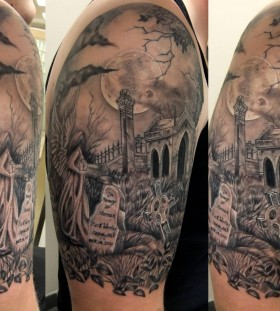 Cool grey ink graveyard tattoo