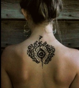Creative bohemian back tattoo
