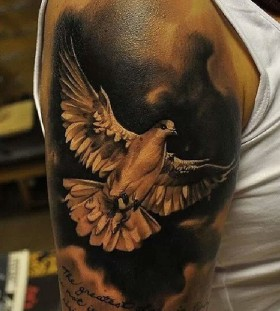 Creative dove arm tattoo