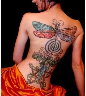 Creative dragon-fly back tattoo