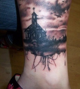 Creepy house and graveyard leg tattoo