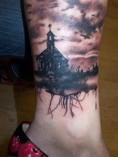 Creepy house and graveyard leg tattoo