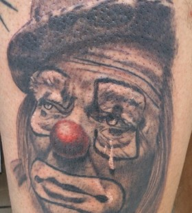 Crying old clown tattoo