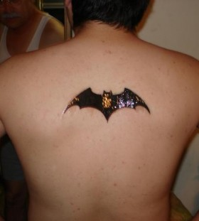 Darknight tattoo on back