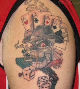Dead man gambling tattoo