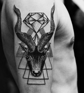 Deer on men's diamond tattoo on arm