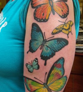 Different lovely red butterfly tattoo