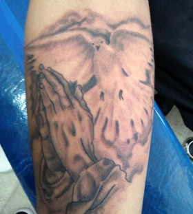 Dove and praying hands tattoo