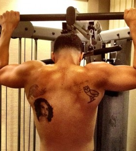 Drake's woman and owl back tattoos