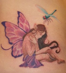 Elf and dragon-fly tattoo