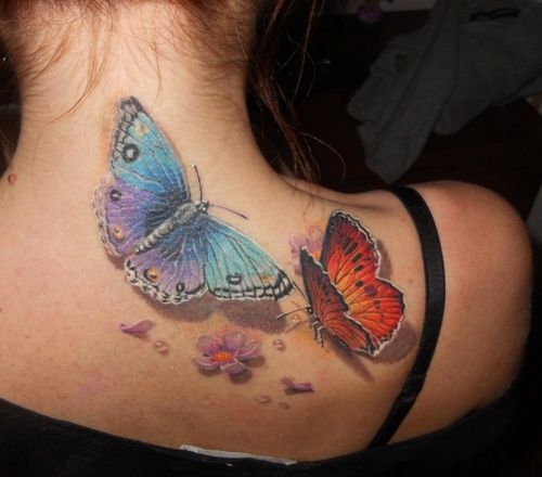 Female blue and red butterfly tattoo