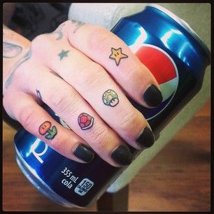 Fingers and pepsi mario style tattoo
