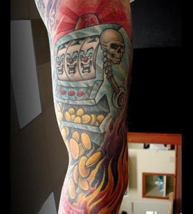 Flaming slot machine arm tattoo