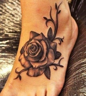 Foot black rose tattoo