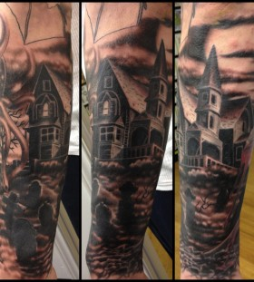 Frightening house and graveyard tattoo