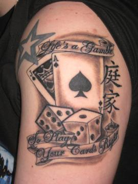 Gambling theme arm tattoo