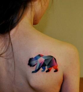 Geometric bear tattoo on back