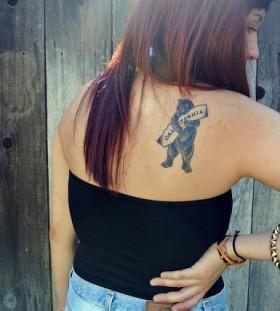 Girl with california bear tattoo on back