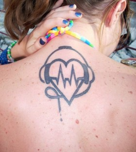 Girl with headphones tattoo on back