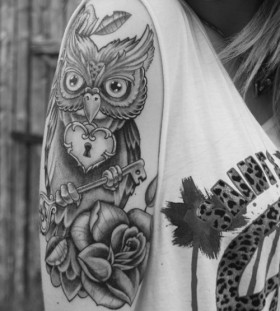 Girl's key and owl tattoo
