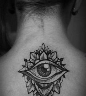 Girl's neck eye tattoo