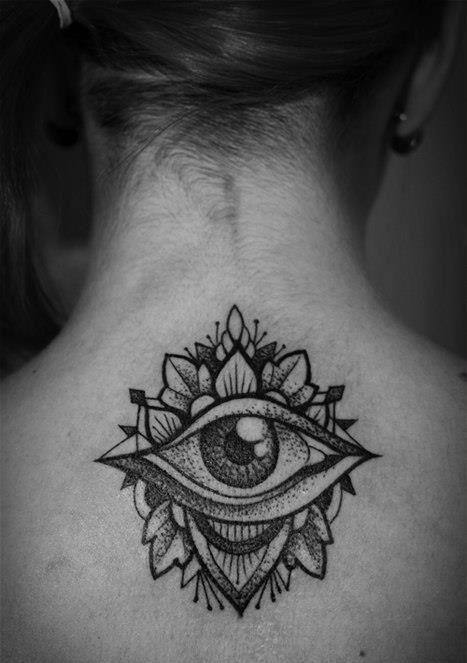 Girl's neck eye tattoo