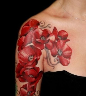 Girl's shoulder's poppies tattoo