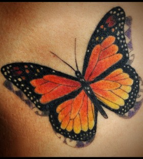 Gorgeous looking red butterfly tattoo
