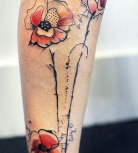 Great black and red poppies tattoo