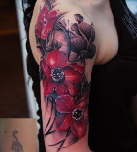 Great poppy flower arm tattoo